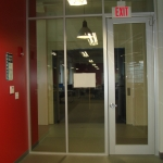 Glass panels with Framed Anodized Full Lite Door